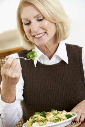 Woman eating a healthy and hearty meal