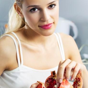 Girl eating pomegranate seeds