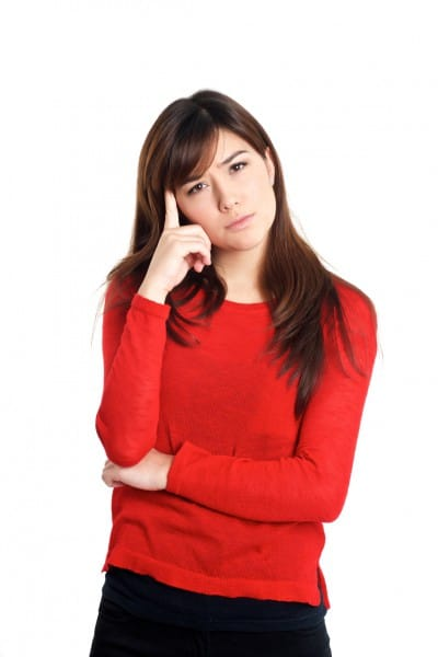 Puzzled girl in a red shirt