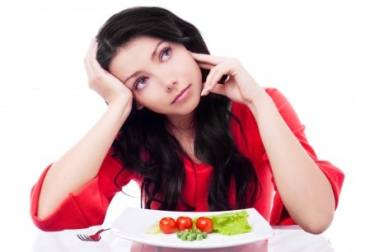 Girl thinking with a salad