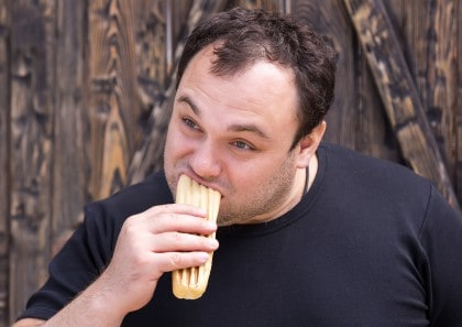 Man Eating Cake or Bread
