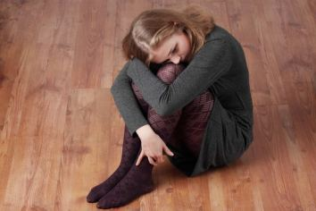 Depressed girl on the floor