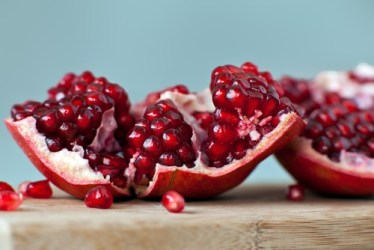 Opened pomegranate with arils