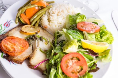 Cooked fish and greens