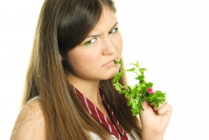 Upset girl with greens