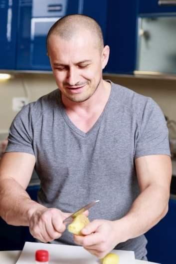 Man peeling ginger