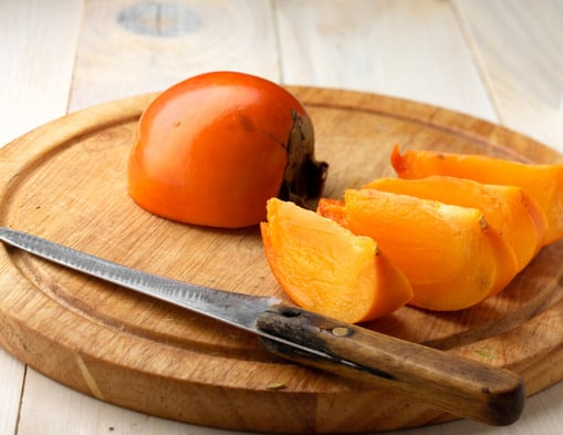 Cut persimmon on a plate