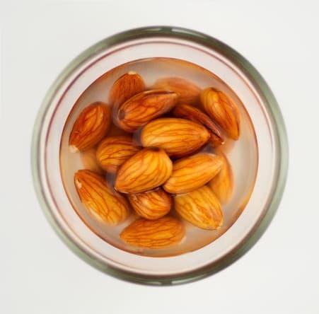 Macro of almonds soaking in water