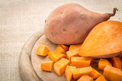 Sweet potato on a cutting board