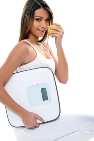 Girl with a scale, weight loss concept