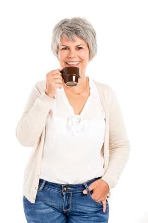 Elderly woman drinking coffee or cocoa