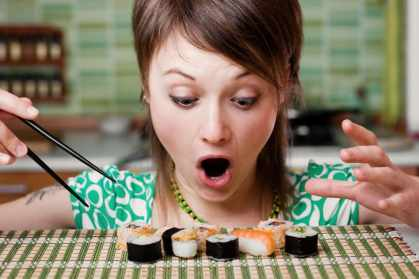 Young woman surprised at sushi