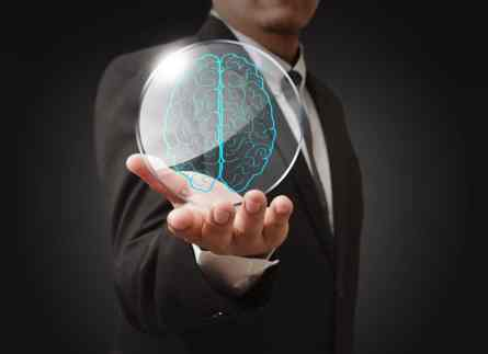 Businessman shows a brain in shield glass as concept