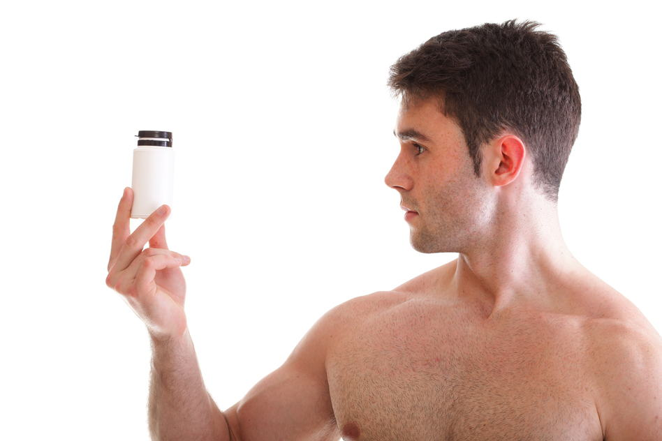 Young man looking at supplement