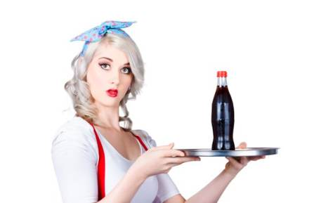 Pinup girl waiter holding silver soda tray