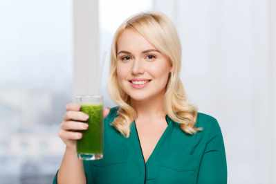 Woman with an alkaline smoothie