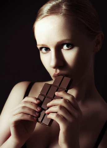 Woman with dark chocolate