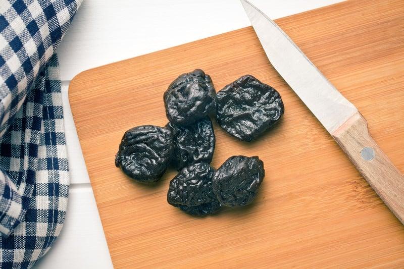 Prunes on a cutting board