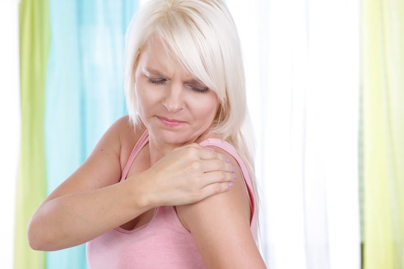 Woman with a sore shoulder, inflammation