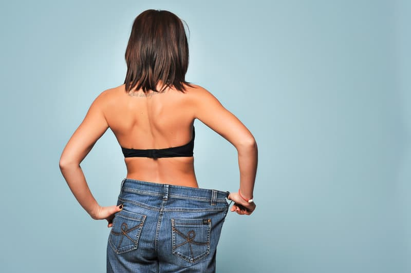 Woman with loose pants has lost weight