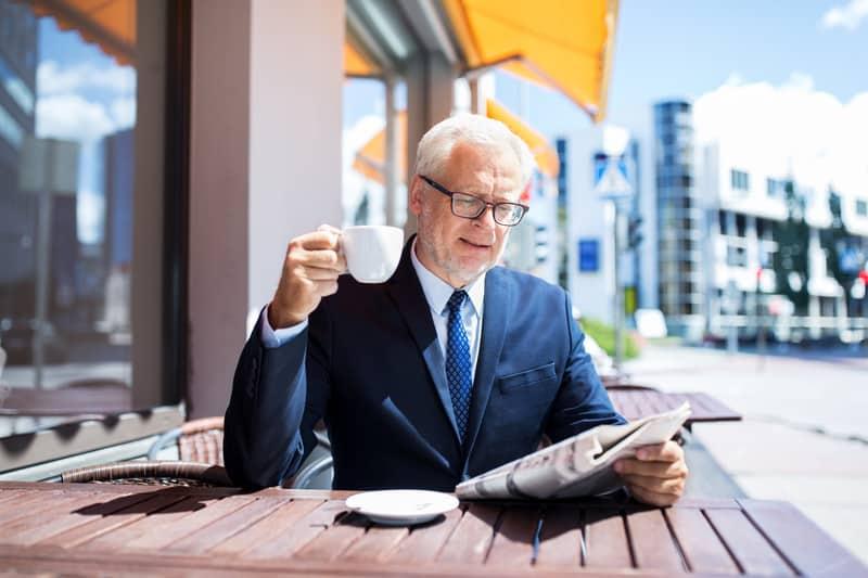 Elderly gentleman drinking coffee