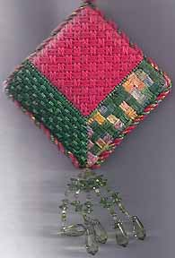 attic window beginner's needlepoint christmas ornament, designed by needlepoint expert janet m. perry