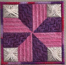 nelsons victory needlepoint quilt block featuring glorian duchess pele and red barn yarns wool, designed and stitched by needlepoint expert janet m.perry