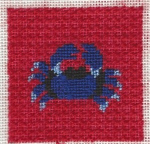 Patty Paints needlepoint crab stitched with non-metallic shiny threads