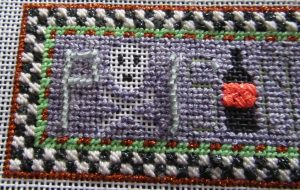 Kathy Schenkel canvas with glow-in-the-dark beads and threads