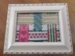 pink and green woven ribbons needlepoint by Kate Dickerson