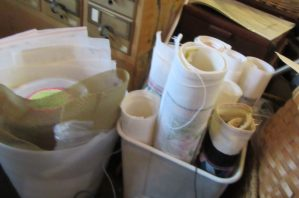 use clean wastepaper baskets to store rolled needlepoint canvas