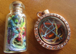 two styles of thread art pendants