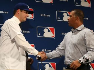 Dec 5, 2016; National Harbor, MD, USA; Los Angeles Dodgers pitcher Rich Hill (left) shakes hands with Dodgers manager Dave Rogers (right) at a press conference announcing Hill