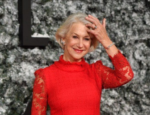 British actress Helen Mirren poses on the red carpet upon arrival at the European premiere of Collateral Beauty in London on December 15, 2016.  / AFP PHOTO / Ben STANSALL