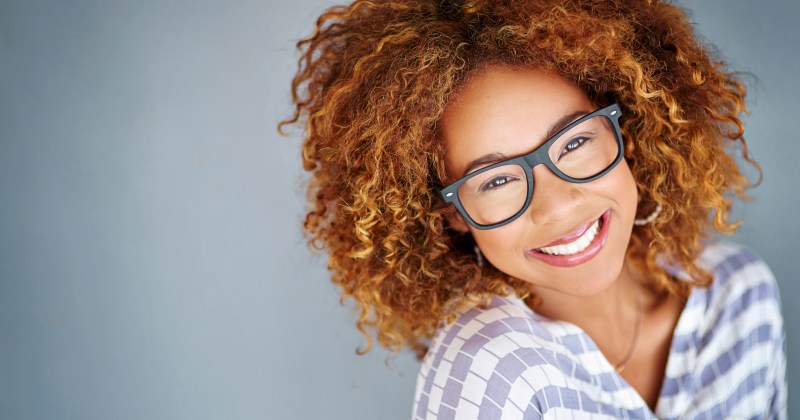 Young woman smiling with glasses