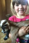 Student holding baby goat