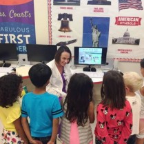 Dental hygienist teaches the first grade class all about proper hygiene