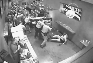 Officer Kolkoski knocks himself down in the process of beating Domonic Generino with his nightstick