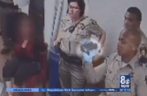 """A guard can be seen filming the abuse of Vera Anderson. That video was """"corrupted,"""" though."""