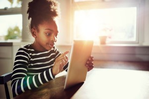 African American girl using iPad