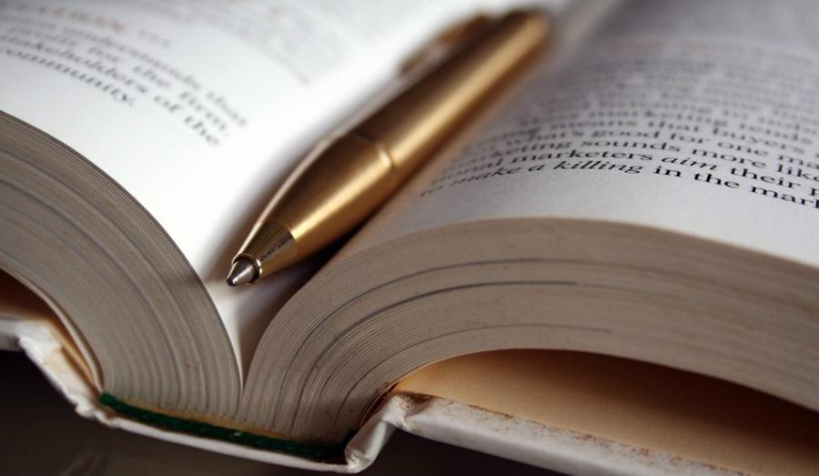 Notulen, boek en pen
