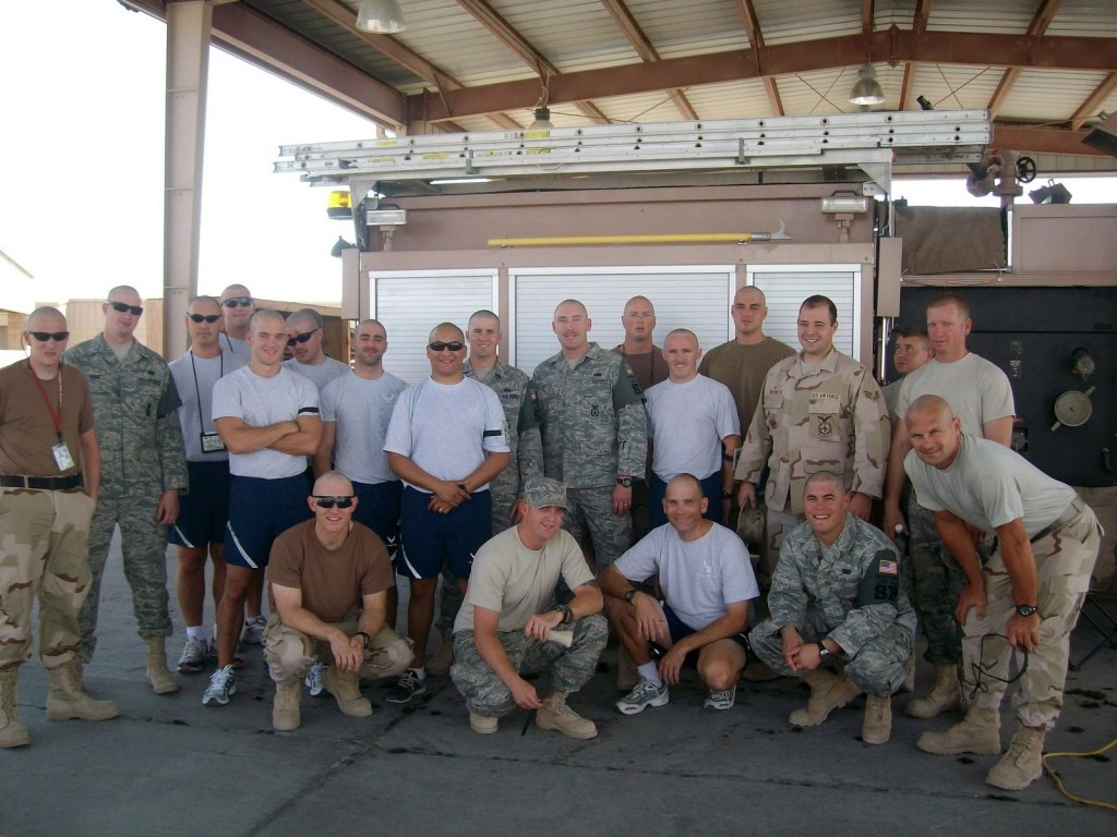 Military people with bald heads after participating in a PEP event