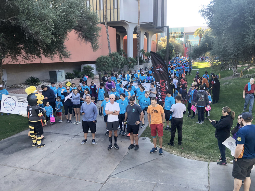 A wide shot of people participating in the Run Walk Roll event