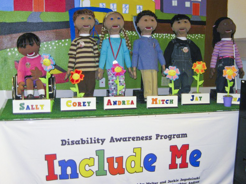 The Include Me puppets arranged on a table