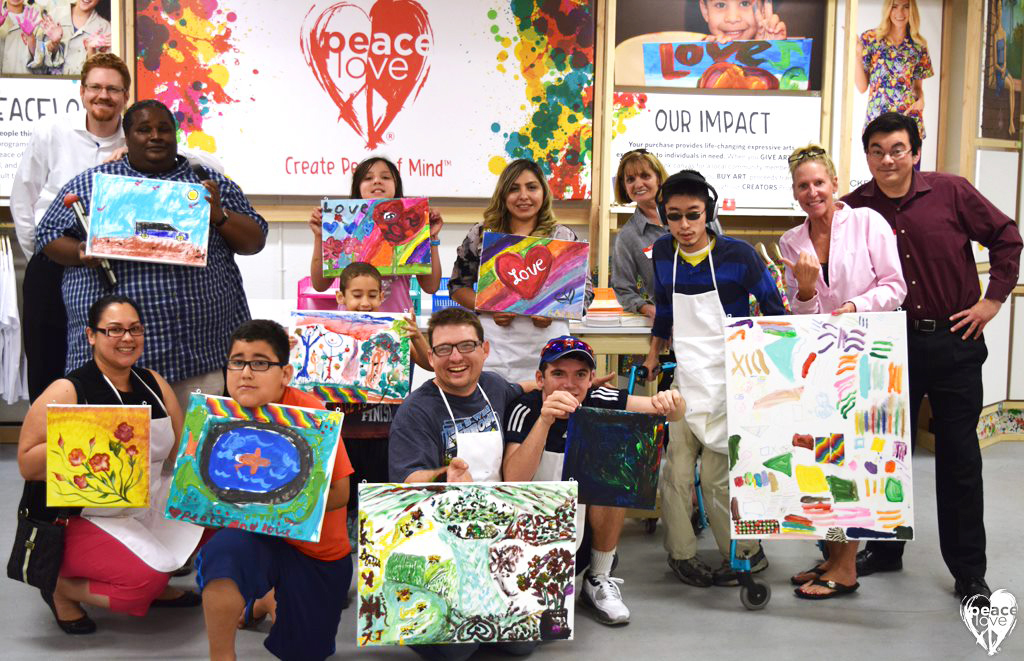 group PEP photo with paintings