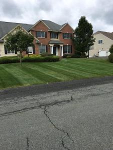 brick house lawn mowing in saratoga