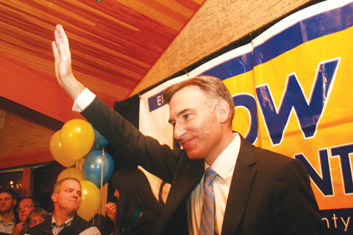 Dow Constantine happily waves to his thick crowd of supporters on election night, Nov. 3, as everyone watches the results trickle in. Constantine took an early lead and maintained it. (Photo by Vivian Luu/NWAW)