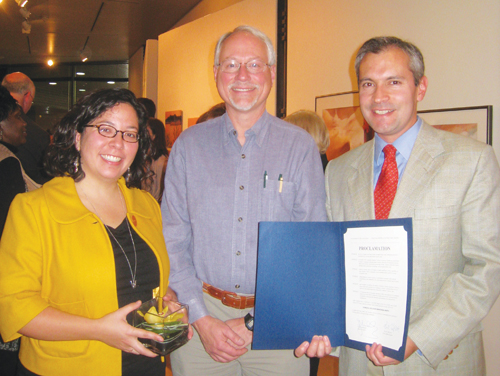 Recognition of the NWIRP by the City of Seattle and King County came during an event at the Columbia Center on Oct. 13.It was presented to Executive Director Jorge L. Barón (right) and attorney Angélica Cházaro (left) by Seattle City Council President Richard Conlin.