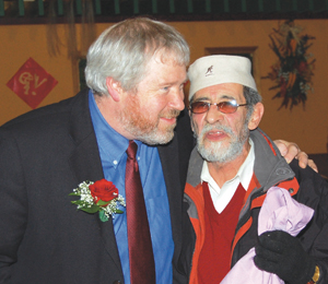 Mayor-elect Mike McGinn with community activist Roberto Maestas at the Top Contributors dinner on Dec. 4.