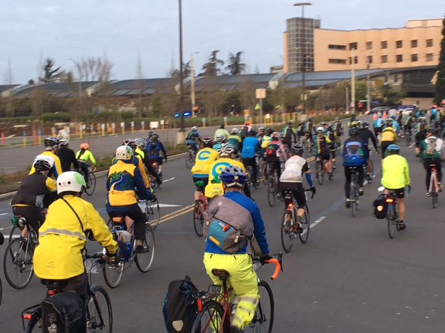 Bikers rush through the starting line.